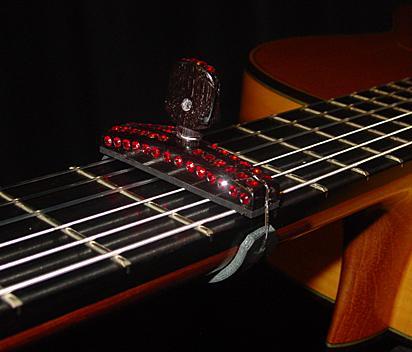 капо для гитары