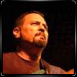 Гитарист Карл Роа